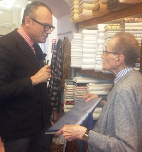 Piero Albertelli showing a rare silk cloth to Cesare Cunaccia