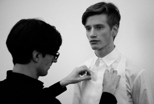 Erïk Bjerkesiö and a model at the backstage of fashion show, photo courtesy of Pitti Immagine