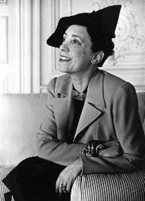 Elsa Schiaparelli wearing the hat she made (1937)
