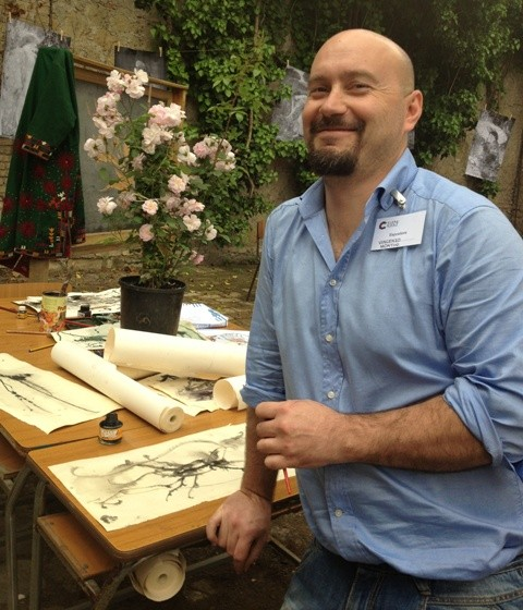 Vincenzo Montini along with the sketches he made that were on show at the School for re-inventors