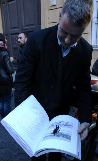"""Lorcan O' Neill showing """"Journal 1992-2012"""" by Renate Graf to a friend, photo by Giorgio Miserendino"""