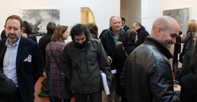 """The bright artist Pietro Ruffo holding his copy of """"Journal 1992-2012"""", by Renate Graf at the Lorcan O' Neill Gallery in the crowd which peopled the gallery, photo by Giorgio Miserendino"""