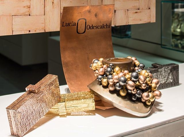 The clutch bag by Rodo and the jewelry by Lucia Odescalchi