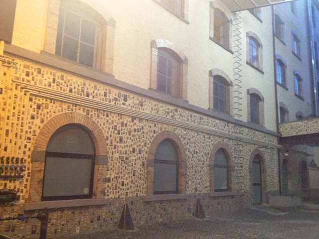 The suggestive building ex-Patificio Cerere where the Aspecifico Atelier is, which seems decorated with a mosaic made of...