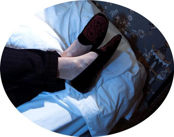 "Cesare Cunaccia, photo by Mustafa Sabbagh, Pinstripe suit Isaia, slippers Max Kibardin, poster bed silk upholstered Rubelli ""Princess Kocacin"", sheets Pratesi"