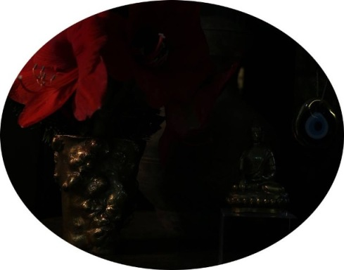 photo by Mustafa Sabbagh, red Amaryllis  in a bronze vase by Gabriella Crespi (early Seventies), Tibet Buddha in golden bronze foil from the 15th century, Greek apotropaic eye