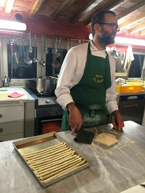 Carlo Porcu and the delicious breadsticks he makes, photo by N