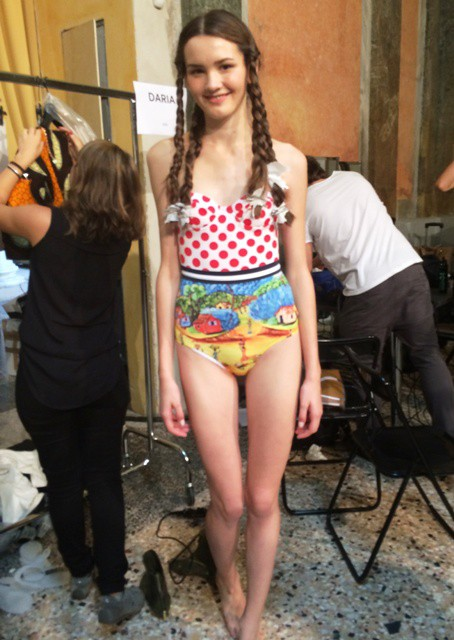 A model at the backstage wearing the swimsuit by Stella Jean, photo by N