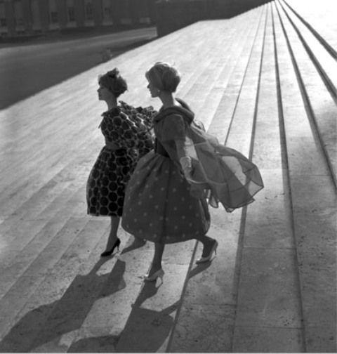 Two models wearing dresses by Valentino walking  in steps of Central State Archive, photo Federico Garolla, Rome, 1958