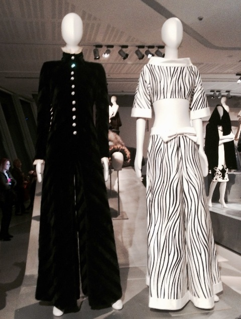 Fendi (Jumpsuit in black rabbit, with diagonally symmetric pattern, adorned with jewel buttons, chiffon and lace on the collar and wrists, Fall/Winter 1067-1968, Fendi Historical Archive) and Valentino (ensemble in cotton mikado, Spring/Summer 1966, courtesy Valentino S.P.A.), photo by N
