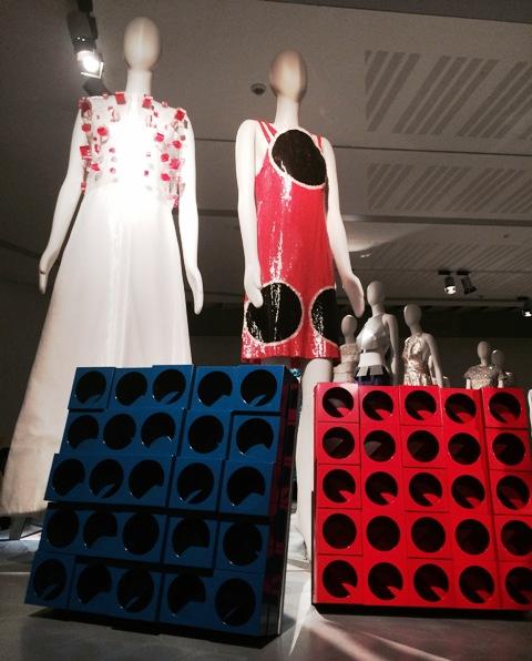 "Dresses by Germana Marucelli( Fall/Winter 1968-1969, courtesy Germana Marucelli archive),  and Roberto Capucci(1967, courtesy Roberto Capucci Archive) along with the artworks ""Inter-ena-cubo"", by Paolo Scheggi(1969, Carla and Cosimo Scheggi collection)"