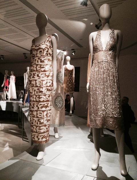 "Germana Marucelli(evening dress with sequins and silk embroidery from patterns by Pietro Zuffi, ""Impero"" collection, 1967, courtesy Germana Marucelli Archive) and Jole Veneziani (organza short dress embroidered with stripes, sequins and jais, Fall/Winter 1968-1969, courtesy Veneziani Archive), photo by N"