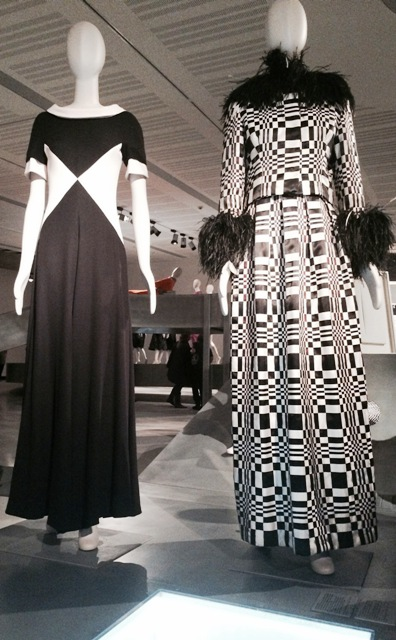 """Valentino( silk evening pyjama, Spring/Summer 1966, courtesy Valentino S.P.A,) and Roberto Capucci, """"Omaggio a Vasarely"""", sculpture-dress inspired by the artist's works with interwoven optical effect satin ribbons and ostrich feathers, 1965, Historical Archive of Roberto Capucci Foundation), photo by N"""