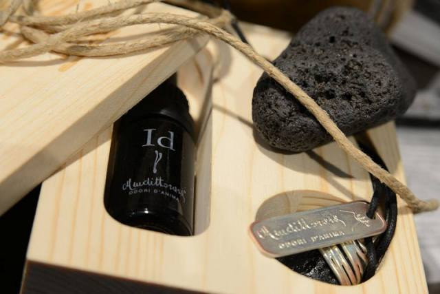 Mendittorosa odori d' anima. a limited edition featuring the perfumed oil an a necklace made of volcanic stone from Stromboli, jewel and scent diffuser