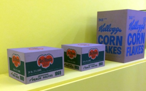 Andy Warhol, Del Monte  peach halves, 1964, Mugrabi Collection, 1964, Kellog's corn flakes box, 1964,  courtesy of the Brant Foundation, Greenwich, photo by N