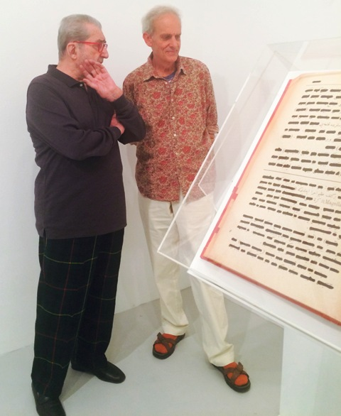 Giorgio Marconi and Angelo Naj Oleari looking at the Ottoman Code of Loneliness by Emilio Isgrò, photo by N
