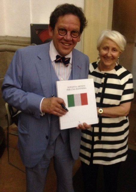 Deanna Ferretti Veroni along with Philippe Daverio showing the catalogue of Ninety artists for one flag