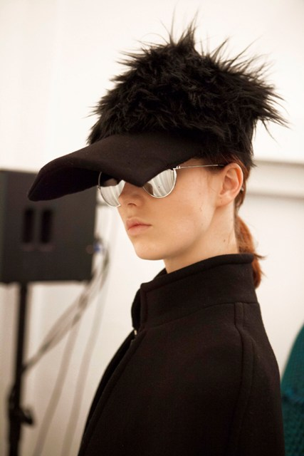 A model at the backstage of Gianluca Capannolo fashion show